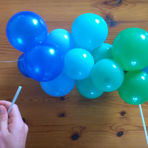 Attaching wire to balloon sticks for custom garland cake topper decoration