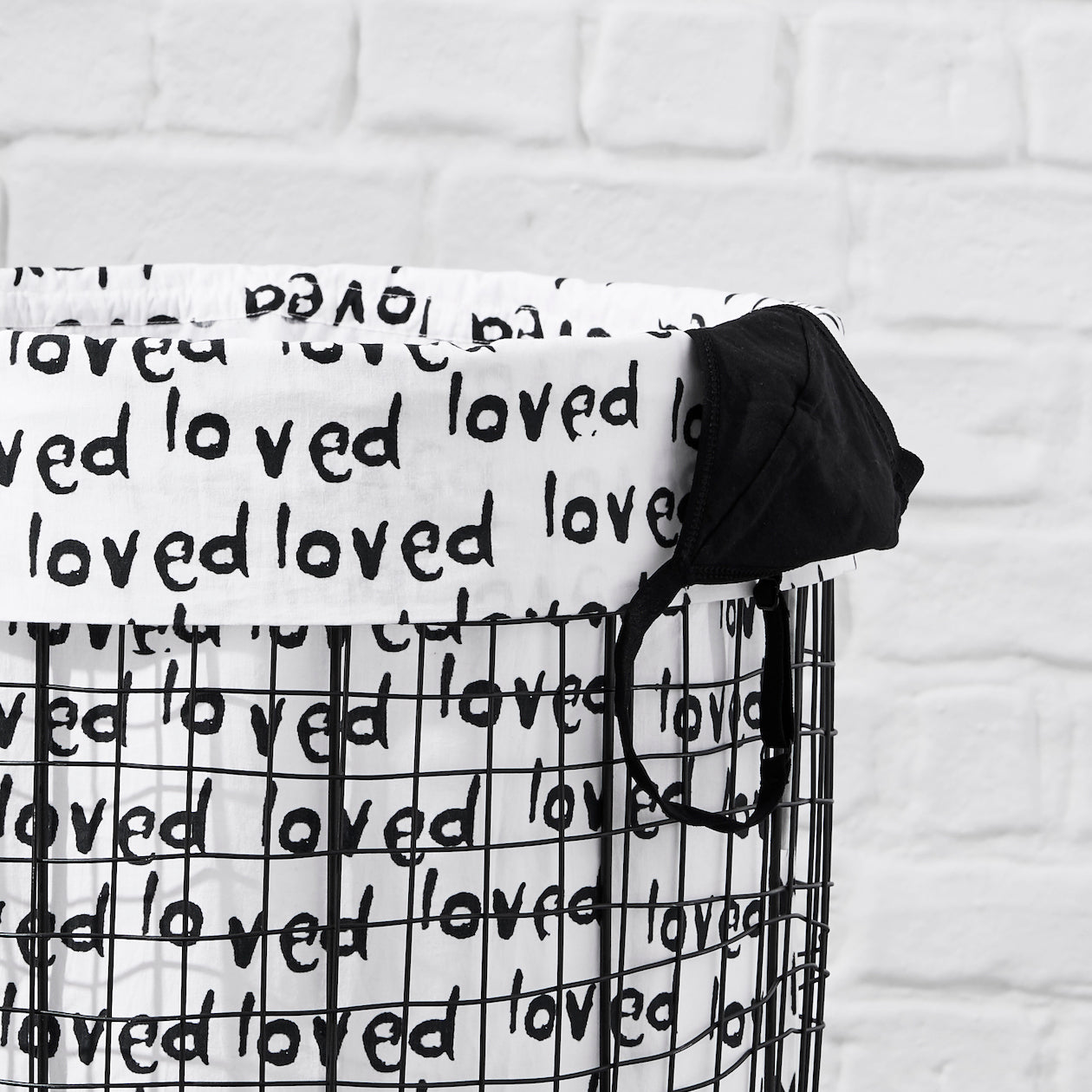 loved print laundry bag black