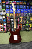 Carlsbro strat style electric guitar in transparent red finish