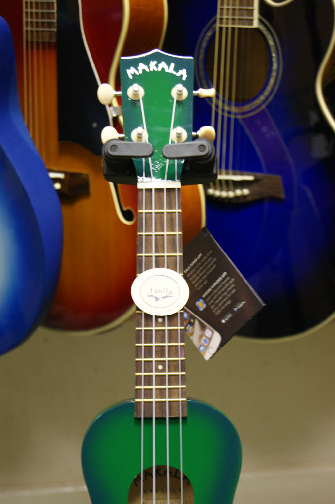 Ukulele by Makala soprano model in Greenburst finish with Dolphin bridge