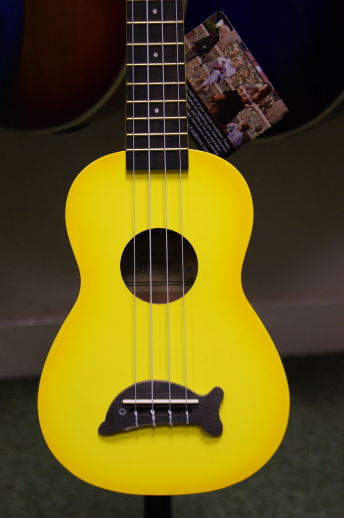 Ukulele by Makala with dolphin bridge in yellowburst finish