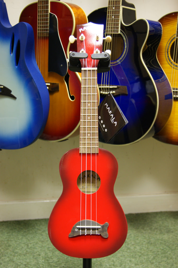 Ukulele by Makala in redburst finish with dolphin bridge