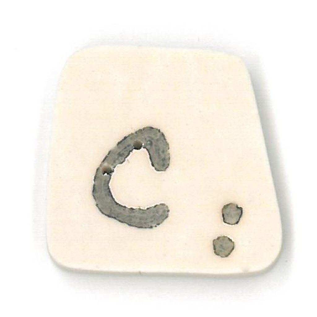 tea-dyed letter c