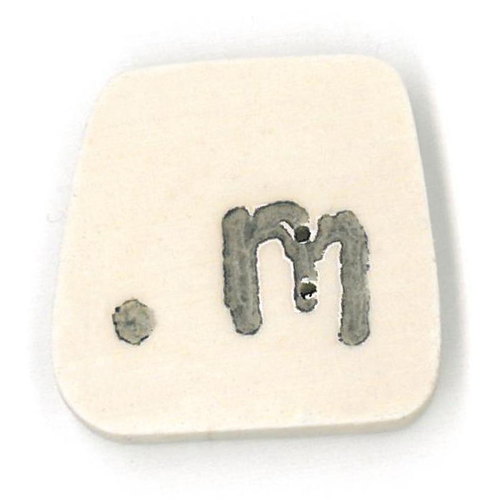 tea-dyed letter m