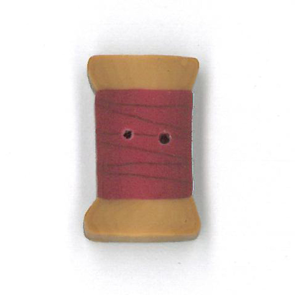 small cherry red spool
