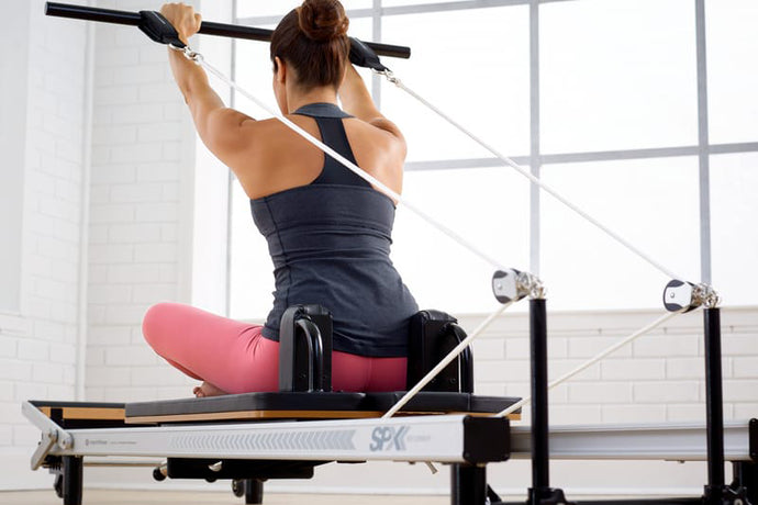 What is the difference between the STOTT SPX At-Home Reformer and the SPX Max?