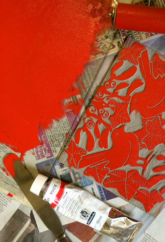 Red ink lino printing mistletoe & ivy