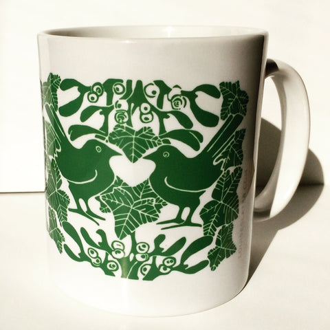 Green mistletoe and blackbirds ceramic mug