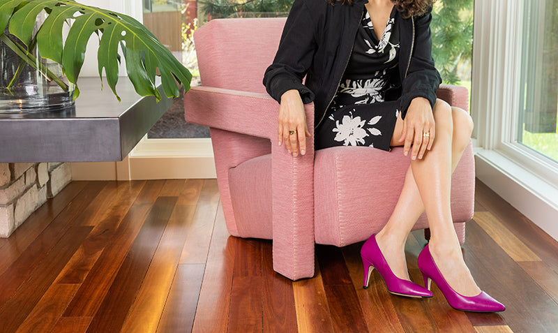 A woman wearing Julieta shoes in violeta | The most comfortable heels ever.