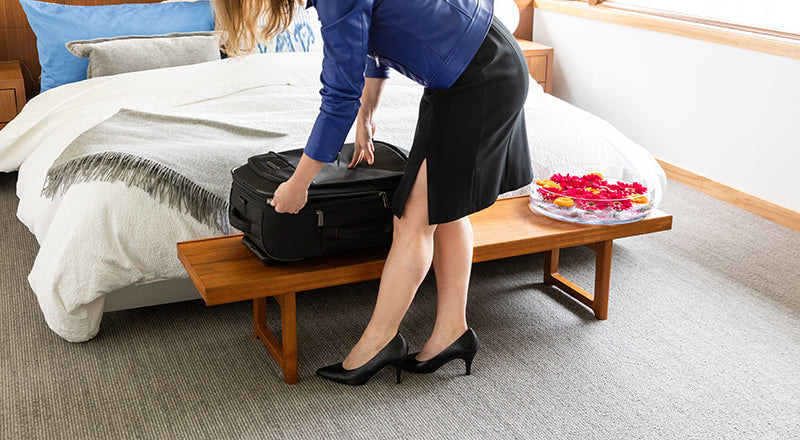 Woman opening her suitcase in a hotel room | Packing Tips for Travel | Julieta | The most comfortable heels ever.