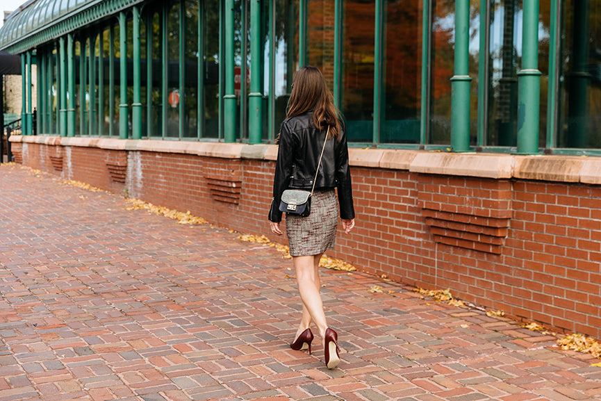 A woman walking on cobblestone at St. Anthony Main. | Dress for Success | Julieta | The most comfortable heels ever.