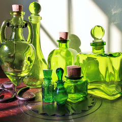 green glass apothecary bottles