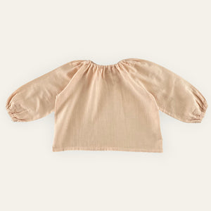 Liilu Blouse - Nude Liilu's signature blouse has an oversized cut and puffed sleeves. With an elasticated neckline, this easy to wear blouse can be paired with shorts, pants or bloomers.  • 100% organic double gauze cotton  • loose fit  • color: nude  • machine wash cold  • made in Portugal
