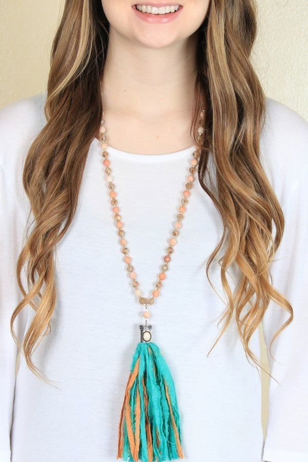 PEACH BEADED NECKLACE WITH IVORY STONE ACCENT & APRICOT/TEAL TASSEL