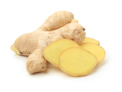 Fresh sliced ginger root on a pure white background.