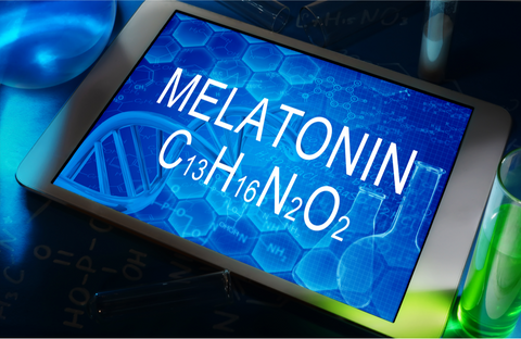 "Ipad with the screen showing a text saying: ""melatonin"" and the molecular structure of melatonin against a blue background."