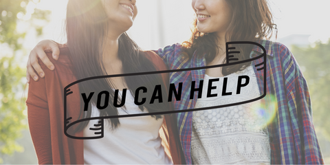 "Two Asian woman standing side by side with text overlaid in front of the photo saying: ""you can help."