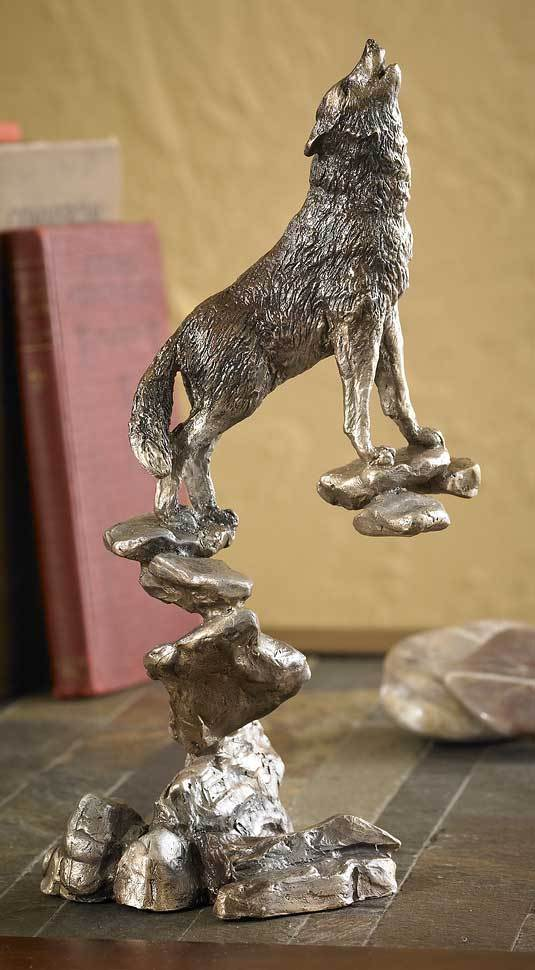 Howling Wolf on Rocks