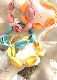 Rainbow of Cowrie shell bracelets
