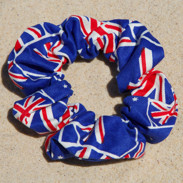 Scrunchies are back and they're here to stay! These stunning scrunchies look great in your hair and also work as gorgeous accessories.  Colour/Pattern: Blue with Australian flags  Material: Cotton  Washing instructions: Cold hand wash  Dimensions: Material width approximately 4 cm  Made by us in Bondi Beach  With love from Larzy xx