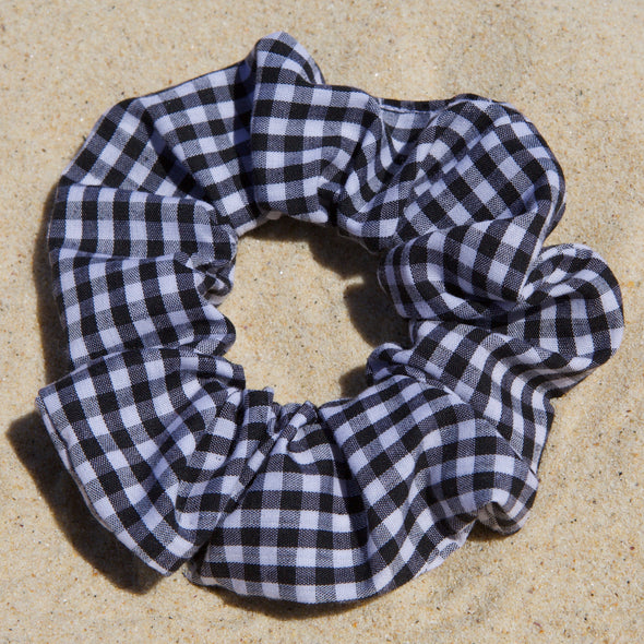Scrunchies are back and they're here to stay! These stunning scrunchies look great in your hair and also work as gorgeous accessories.  Colour/Pattern: Black and white gingham  Material: Cotton  Washing instructions: Cold hand wash  Dimensions: Material width approximately 4 cm  Made by us in Bondi Beach  With love from Larzy xx