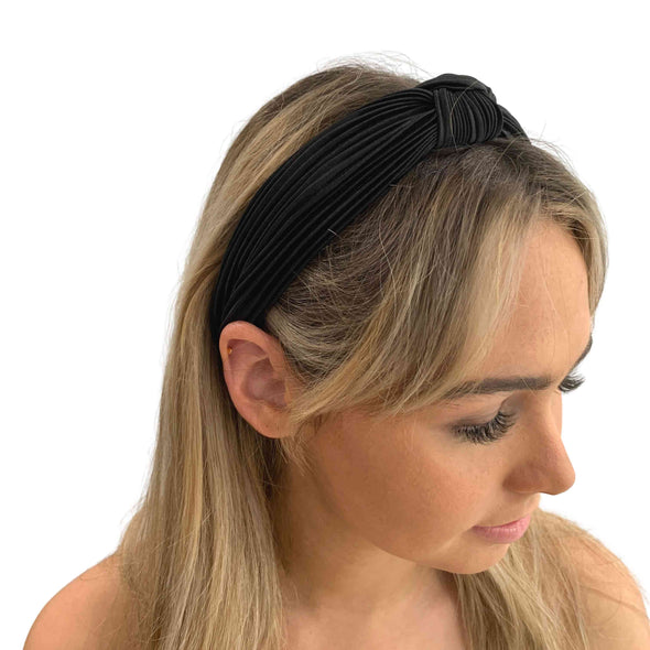 Gorgeous black crinkle fabric top knot headband. Set on a black fabric covered headband.  Really comfortable.  Great accessory for any outfit.  Dimensions: Inside headband is approximately 3cm wide. Top knot is approximately 4cm wide and fabric on sides can be stretched out to 6cm wide although when worn sits about 4cm wide.  Imported