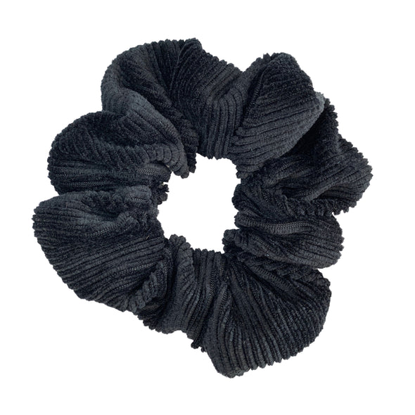 Scrunchies are back and they're here to stay! These stunning scrunchies look great in your hair and also work as gorgeous accessories.  Colour/Pattern: Black Material: Soft Corduroy  Washing instructions: Cold hand wash  Dimensions: Material width approximately 4 cm  Made by us in Bondi Beach  With love from Larzy xx