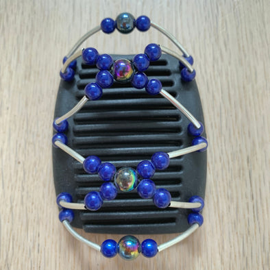 Fine black hair comb with holographic and blue beads