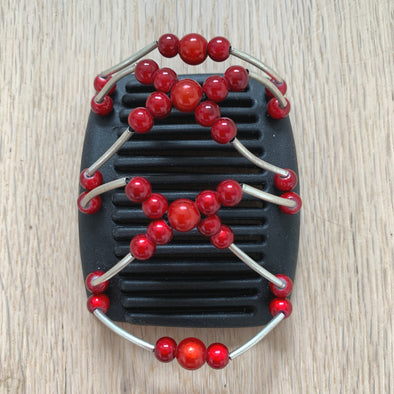 Fine black hair comb with orangey-red centre beads and red beads