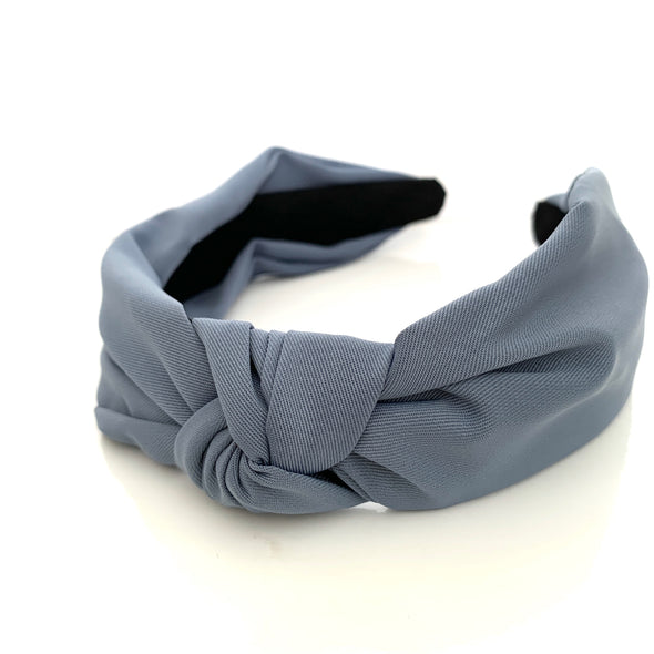 Quite possibly one of the most comfortable headbands you'll ever own!  Gorgeous soft, super comfortable fabric headband in blue (similar colour to Pantone's Zen Blue) with top knot. Inside of headband is lined with suede-like material.  Colours available: Black, Brown (Tan colour), Dark Green, Blue, Navy, Khaki, Mustard (Yellow), Dusty Pink, Blue and Red (deep red not bright red!)  Care: Use clean damp cloth  Origin: Imported