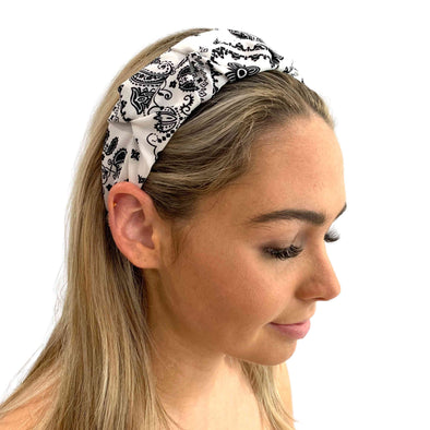 Stunning white headband with a beautiful black paisley pattern.  Super light weight, perfect for a summer's day!  Dimensions: Approx 5cm wide  Imported