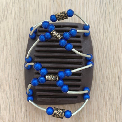 Fine brown hair clip with copper gold centre beads and blue beads