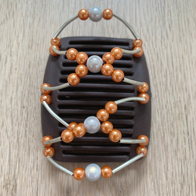 Fine brown hair clip with silver centre beads and orange circular beads
