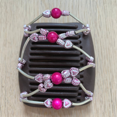 Fine brown hair comb with pink centre beads and pale pink metallic hearts