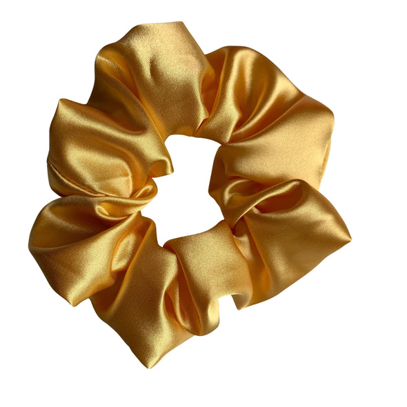 Scrunchies are back and they're here to stay! These stunning scrunchies look great in your hair and also work as gorgeous accessories.  Colour/Pattern: Golden yellow Material: Satin  Washing instructions: Cold hand wash  Dimensions: Material width approximately 5 cm  Made by us in Bondi Beach  With love from Larzy xx