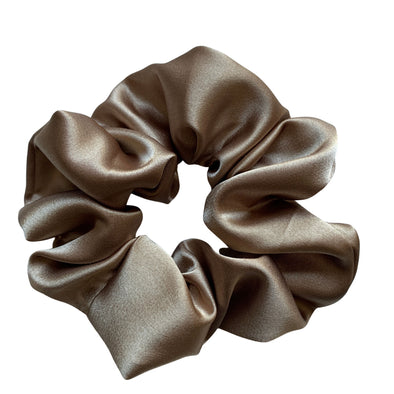 Scrunchies are back and they're here to stay! These stunning scrunchies look great in your hair and also work as gorgeous accessories.  Colour/Pattern: Bronze  Material: Satin  Washing instructions: Cold hand wash  Dimensions: Material width approximately 5 cm  Made by us in Bondi Beach  With love from Larzy xx