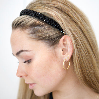 Love this! Gorgeous black crystal headband.  The light catches the crystals and they shine from all angles as you move.  Dimensions: Width 1.5cm, Height 14cm from top of headband to centre of bottom   One size.  Dresses up any outfit!
