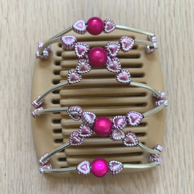Fine blonde hair comb with pink centre bead and pale pink metallic heart decoration