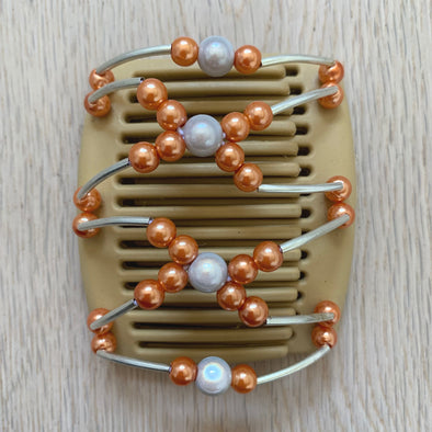 Fine blonde hair comb with silver/white centre beads and orange circular beads