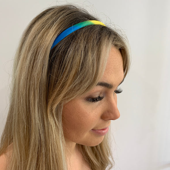 Super cute rainbow headband, gorgeous as an accessory to any outfit.  Really comfortable.   Dimensions: 13 cm from top centre to bottom. 1 cm width   One size only - imported