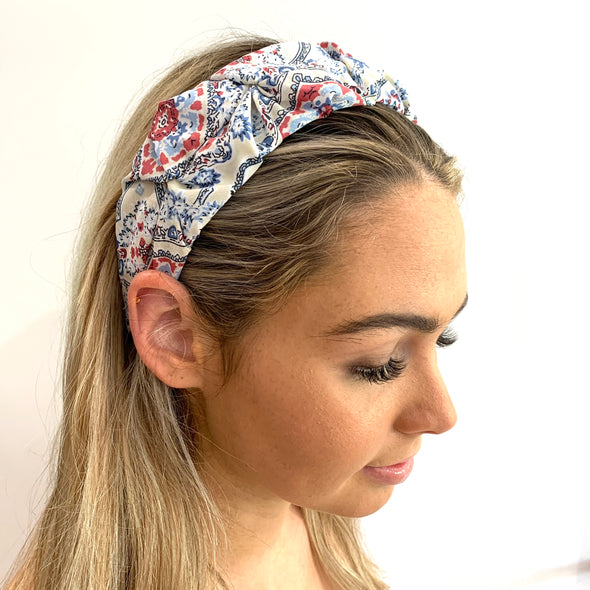 Cream Headband with a beautiful floral coloured fabric, including shades of blue and red.  Super light weight, perfect for a Summer's Day!  One Size fits all.