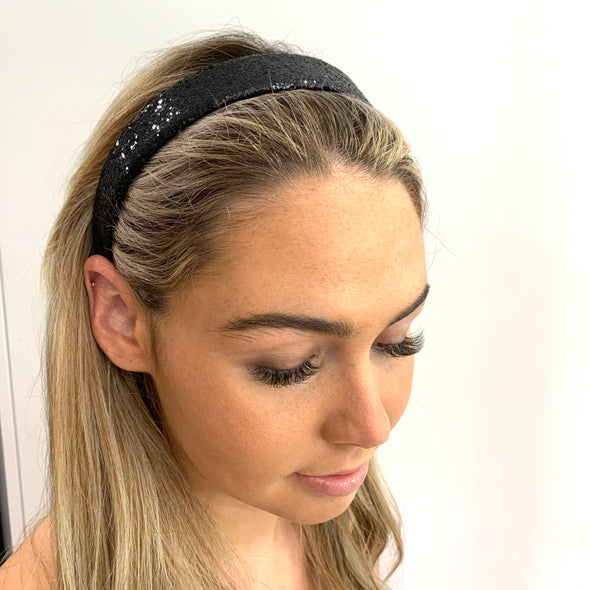 Black Glitter Headband.  Black fabric lining along the inside.  Perfect hair accessory for a night out!  One size fits all.