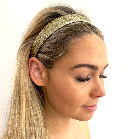 Gold Glitter Headband.  White fabric lining along the inside.  Perfect hair accessory for a night out!  One size fits all.