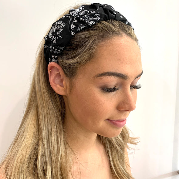 Stunning Headband with a beautiful black paisley pattern, including white patterns.  Super light weight, perfect for a Summer's Day!  One Size fits all.