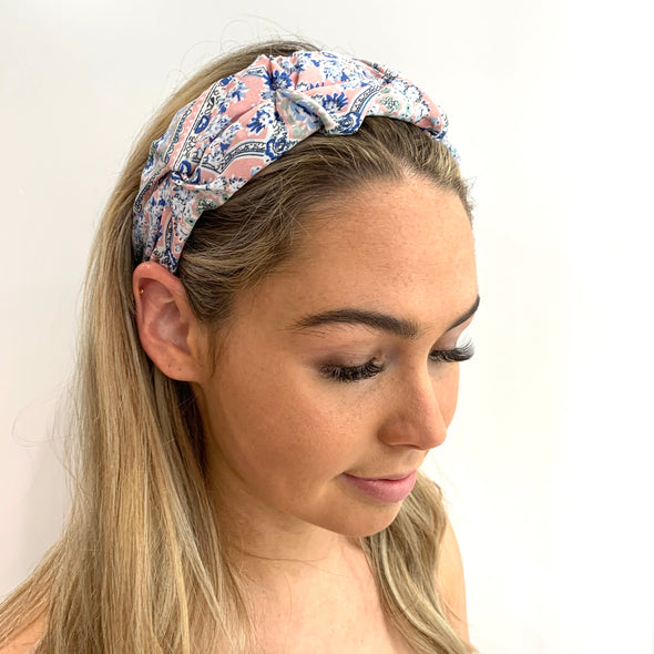 Stunning Headband with a beautiful floral pink coloured fabric, including shades of blue and green.  Super light weight, perfect for a Summer's Day!  One Size fits all.