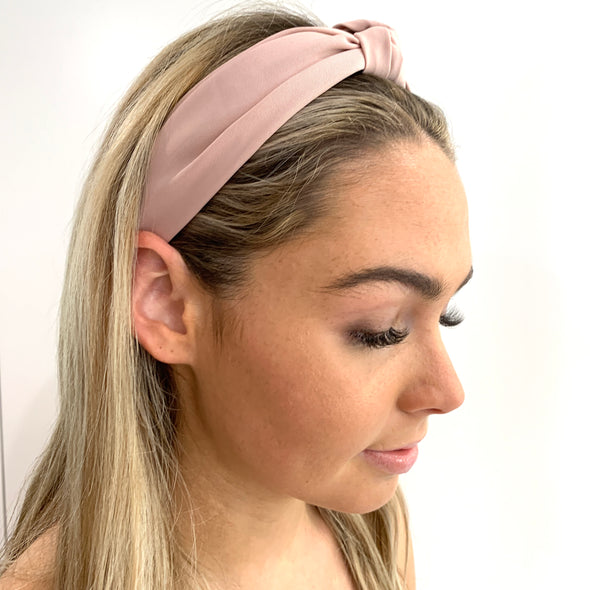 Gorgeous soft, super comfortable fabric headband in pale pink with top knot. Inside of headband is lined with suede-like material.  Colours available: Black, Brown (Tan colour), Khaki, Dark Green, Blue (similar to Pantone Zen Blue), Navy, Mustard (Yellow), Dusty Pink and Red (deep red not bright red!)  Care: Use clean damp cloth  Origin: Imported