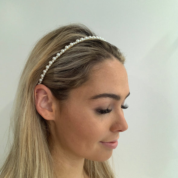 Stunning pearl decor headband set on gold band, dresses up any outfit.   Dimensions: 0.5cm width, 15cm from top centre to bottom   One size only - imported.
