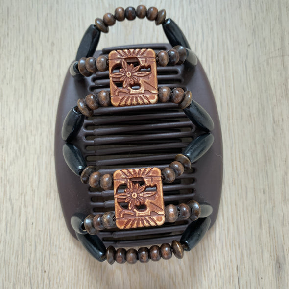 Medium brown hair clip with black and brown beading and decorative centre piece