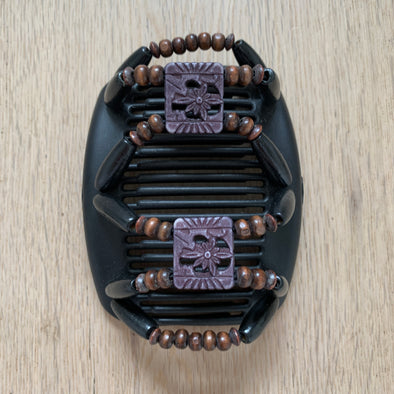 Medium black hair comb with black and brown beading, as well as decorative middle beads.