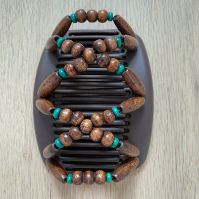 Medium brown hair clip with dark wooden beads and green outer beads.